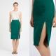 Que puis-je porter avec une jupe crayon verte?